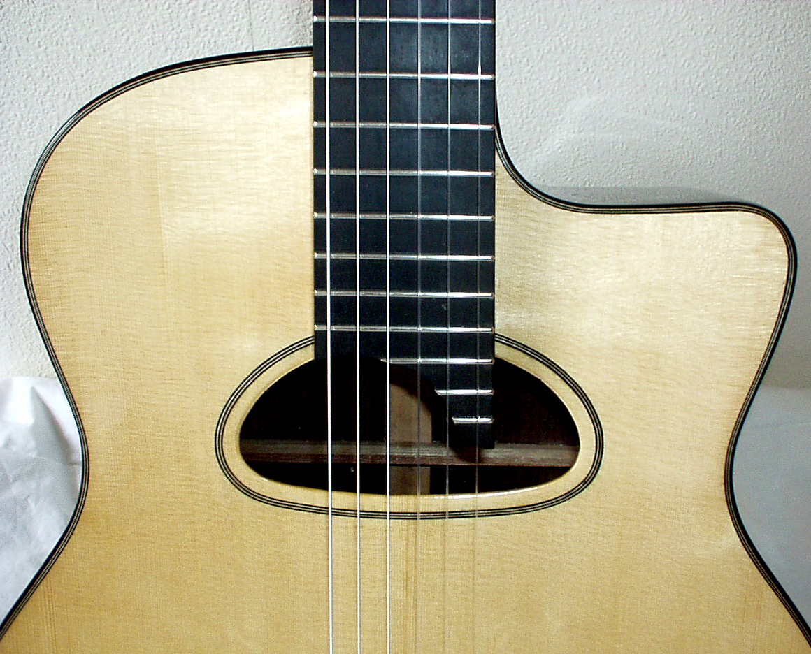 Soundhole with the small D shape